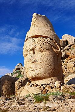 Broken statue around the tomb of Commagene King Antiochius, on top of Mount Nemrut, Turkey