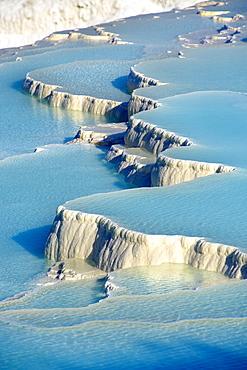 Pamukkale travetine terrace, white calcium carbonate rock formations, Turkey