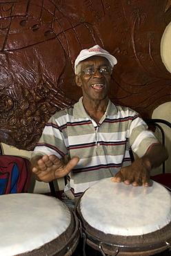 Musician playing drums in the Casa de la Trova, Trinidad, Sancti Spiritus Province, Cuba, Caribbean