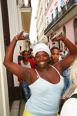 Dancing woman, spectator at a parade in Havana, Cuba, Caribbean, Americas