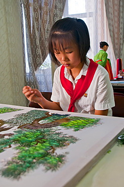 Girl practicing calligraphy, one of the selected children in the Children's Palace, Pyongyang, North Korea, Asia