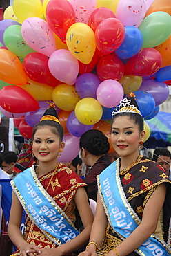 Festival, two beautiful young women of the Lao Loum ethnic group, beauty pageant, beauty queens, traditional clothes, hair styles, colourful balloons, Muang Xai, Udomxai province, Laos, Southeast Asia, Asia