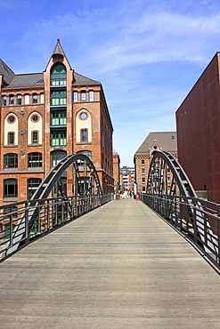 Bridge crossing a fleet with old buildings in the Speicherstadt, the historic warehouse district, Hanseatic City of Hamburg, Germany, Europe