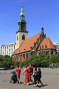 Tourists in front of Marienkirche Church on Alexanderplatz Square in Berlin, Germany, Europe