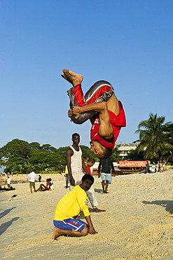Acrobats practicing on the beach of Stone Town, Zanzibar, Tanzania, Africa
