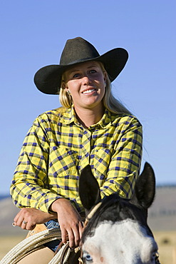 Cowgirl sitting on horse, Oregon, USA