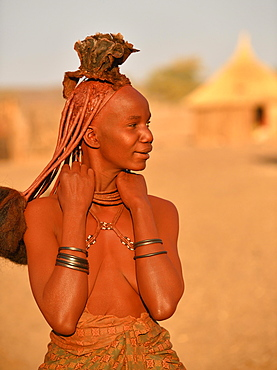 Portrait of a young, married Himbafrau with hair ornaments, Kaokoveld, Namibia, Africa