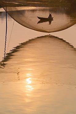 Fishing net and boatman, River Thu Bon, Hoi An, Vietnam, Asia