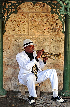 Cuban trumpet player performing in a small park, Havana, Cuba, Central America