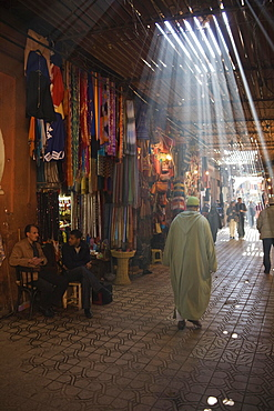Sun rays filtering through beams at the souks of Marrakesh, Morocco, Africa