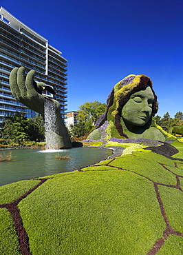 Plant sculpture, Mother Earth with modern building behind, Gatineau, Quebec Province, Canada, North America
