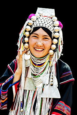 Akha hill tribe woman in traditional dress, northern Thailand