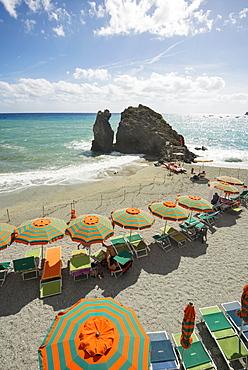 Sandy beach and colorful sunshades, Monterosso al Mare, Cinque Terre, La Spezia Province, Liguria, Italy, Europe