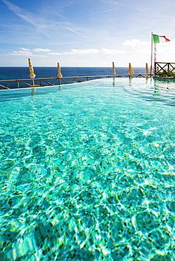 Swimming pool and the Mediterranean with the flag of Italy, Monterosso al Mare, Cinque Terre, La Spezia Province, Liguria, Italy, Europe