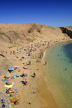Bathing on the beach, Playas de Papagayo or Papagayo beaches, Monumento Natural de los Ajaches nature park, Lanzarote, Canary Islands, Spain, Europe