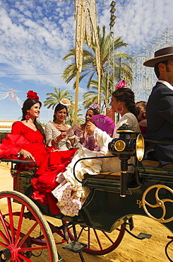 Young ladies wearing gypsy dresses at the Feria del Caballo Horse Fair, Jerez de la Frontera, Cadiz province, Andalusia, Spain, Europe
