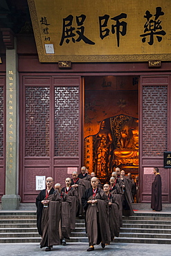 Devout monks leaving a temple, Lingying Monastery, Xihu, Hangzhou, Zhejiang Province, China, Asia