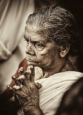 Praying woman at Hindu temple festival, Thrissur, Kerala, South India, India, Asia