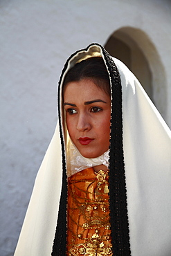 Young woman in traditional costume taking part in a parade, Ibiza, Spain, Europe