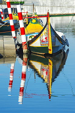 Moliceiro boat anchored on a canal, Aveiro, Centro region, Portugal, Europe