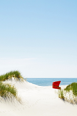 Red beach chair in the dunes by the sea, Amrum, North Frisian Islands, Schleswig-Holstein, Germany, Europe