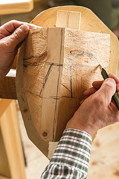 Drawing the outline of a face on a wooden block, wooden mask carver, Bad Aussee, Styria, Austria, Europe