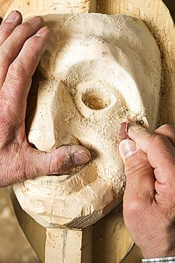 Sanding the face of a wooden mask, wooden mask carver, Bad Aussee, Styria, Austria, Europe