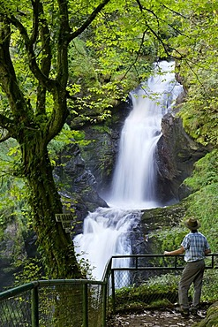 Man in front of waterfall, Gimel les Cascades, Correze, France, Europe
