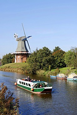 Excursion boat and a windmill, one of the twin mills of Greetsiel, East Frisia, Lower Saxony, Germany, Europe