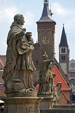 Statues on the Alte Mainbruecke, Old Main Bridge with the towers of downtown Wuerzburg at back, Lower Franconia, Bavaria, Germany, Europe