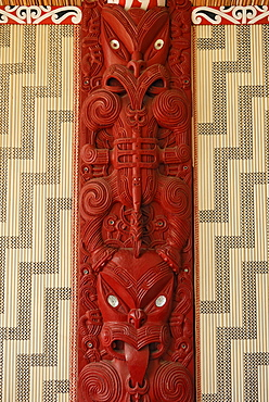 Maori carving, wooden relief with mother of pearl inlays, figural representation and ornaments, Maori Meeting House, Waitangi Treaty Grounds, Waitangi, North Island, New Zealand