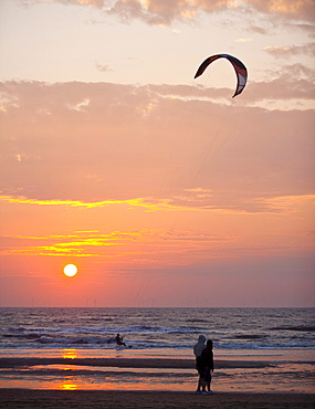 Kite surfer on the beach of Egmond aan Zee at sunset, Netherlands, Europe