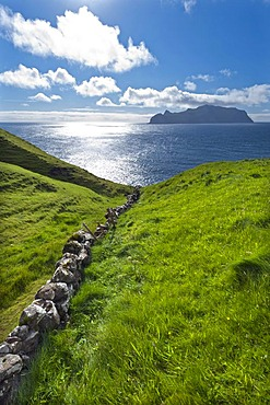 Old stone walls, view towards Mykines Island, Gasadalur, Vagar, Faroe Islands, Denmark, North Atlantic