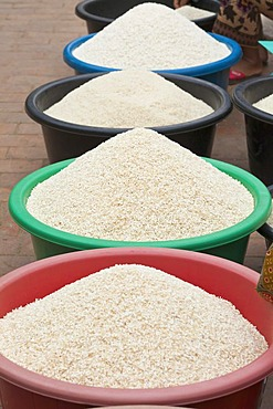 Tubs of rice for sale at the morning market in Luang Prabang, Laos, Southeast Asia.