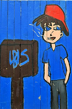Naughty teenager wearing baseball cap smoking a cigarette, painted fence, designed by pupils, Muelheim an der Ruhr, Ruhr Area, North Rhine-Westphalia, Germany, Europe, PublicGround