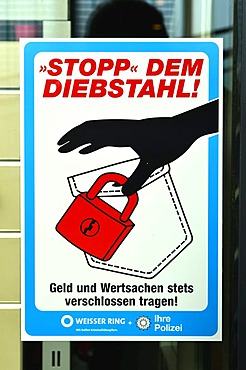 """Stopp dem Diebstahl, Geld und Wertsachen stets verschlossen tragen"", German for ""stop theft, always cover up your money and valuables"", sign in a shop window, prevention, Weisser Ring, association to stop and prevent crime, police, Borken, Muensterland,"
