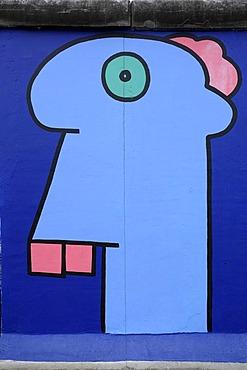 Head in a comic style, painting by Thierry Noir, Berlin Wall, East Side Gallery, Berlin, Germany, Europe