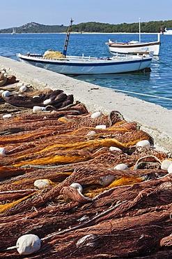 Fishermen have spread out their nets at the roadside for drying, Rgoznica, central Dalmatia, Dalmatia, Adriatic coast, Croatia, Europe, PublicGround