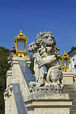 A lion sculpture and lanterns at Nymphenburg Palace, Munich, Bavaria, Germany, Europe