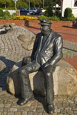 Farmer with a dog, a bronze statue created by Albert Bocklage to commemorate 200 years of sheep trading on the Wittmund market, Wittmund, Eastern Friesland, Lower Saxony, Germany, Europe