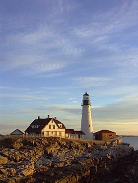 Portland Head Lighthouse illuminated by warm morning light, Cape Elizabeth, Maine, USA