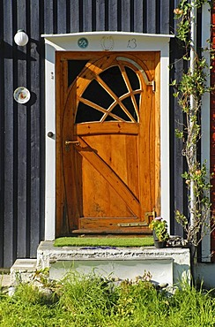 A fancy wooden door, KabelvÂg, VÂgan, Lofoten, Nordland, Norway, Europe
