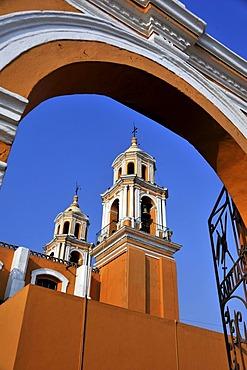 Archway and towers of the church of Iglesia Nuestra Senora de los Remedios, built on the pre-Hispanic Pyramid of Cholula, San Pedro Cholula, Puebla, Mexico, Latin America, North America
