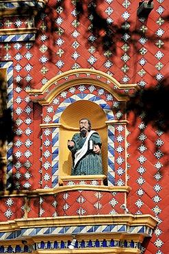 Statue of an evangelist with indigenous features in the facade of the church of Iglesia Santa Maria de Tonantzintla, San Pedro Cholula, Puebla, Mexico, Latin America, North America