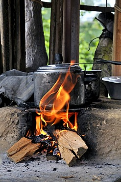 Pressure cooker on stove made of clay with a wood fire, Acampamento 12 de Otubro landless camp, Movimento dos Trabalhadores Rurais sem Terra, a Brazilian landless movement, MST, Munizip Claudia, Mato Grosso, Brazil, South America