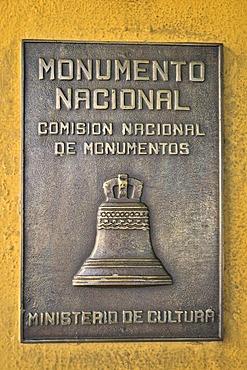 Monumento Nacional plaque on facade of the Moncada Barracks, now school centre and historical museum; the fight of revolutionaries around Fidel Castro against the Batista regime commenced here on 26 July 1953, Santiago de Cuba, Cuba, Caribbean