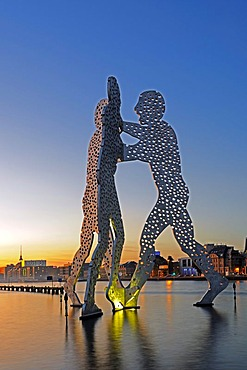 Molecule Men, 30 metre high work of art made of aluminum, sculptor Jonathan Borofsky, standing in the Spree River at sunset, Berlin, Germany, Europe, PublicGround