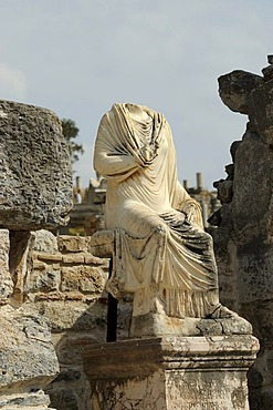 Headless torso, excavations, Ephesus, Efes, UNESCO World Heritage Site, Curetes Street with marble statue, Selcuk, Lycia, Southwest Turkey, west coast, Western Turkey, Turkey, Asia Minor, Asia