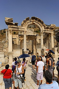 Hadrian's Temple on Curetes Street with tourist group, excavations, ruins at Ephesus, Efes, World Heritage Site, Selcuk, Lycia, Southwest Turkey, West Coast, Western Turkey, Turkey, Asia Minor