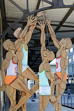 Basketball players, wooden figures by Otl Aicher, Deutsches Sport- und Olympia-Museum or German Sports and Olympic Museum, Rheinauhafen district, Cologne, North Rhine-Westphalia, Germany, Europe